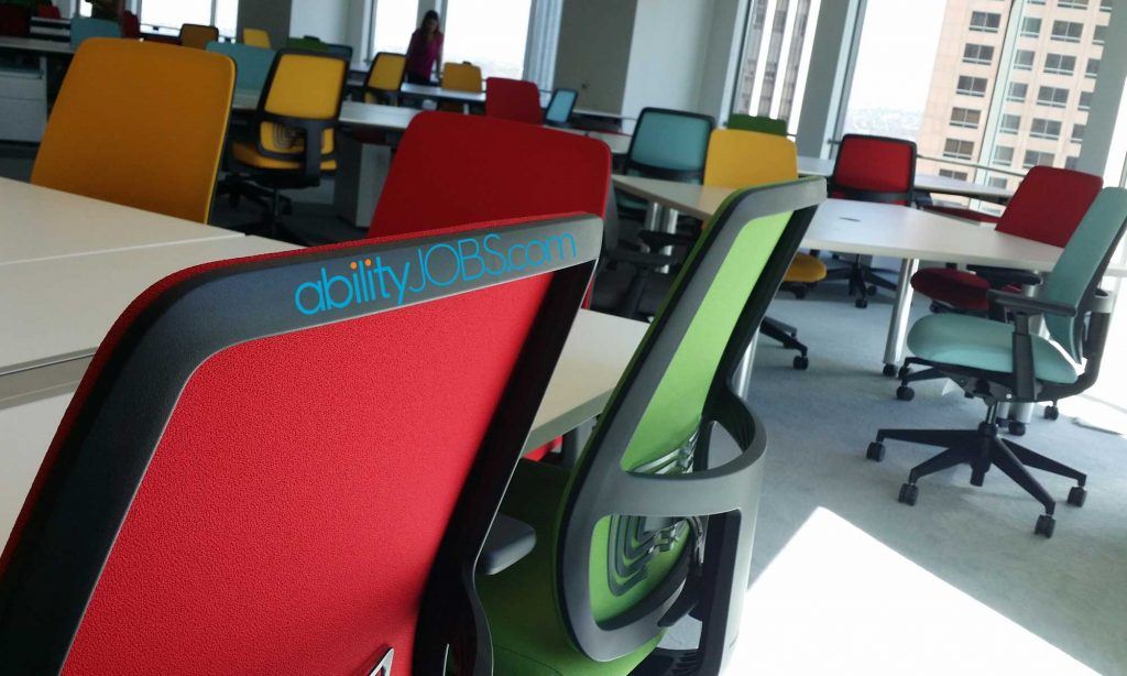 colorful office chairs with abilityjobs logo